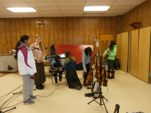 visiting and helping kids try out instruments