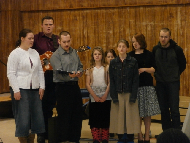 "the teen group sang ""How Deep the Father's Love for Us"""