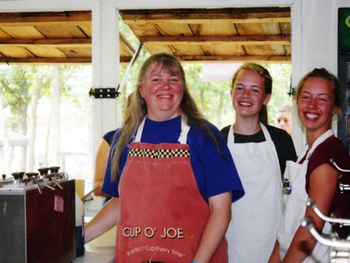 "Mama, the faithful ""Snack Shack Queen"" with cheerful workers"