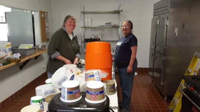 Mom and Mrs. Pollock cleaning the camp kitchen